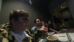 Andy feeds Cyr at Karaoke