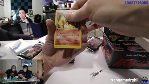 Train unboxes a holo charizard card in a 1st edition booster box