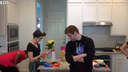 Kevin Whipaloo plays with a kids toy