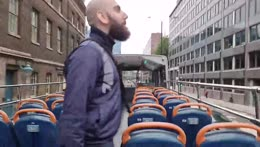 Sliker waves at a bus from his bus