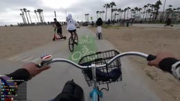 Bicycle guy flexes with a wheelie