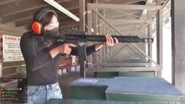 Jinny shooting an M4