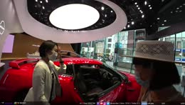 Tracy inside a red GTR