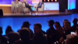 Andy asks Elon Musk a question.