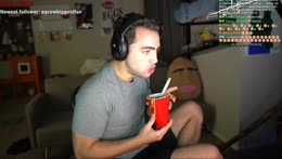 Mizkif eating spaghetti from a cup