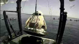 NASA/SpaceX capsule is lifted out of the water successfully!!