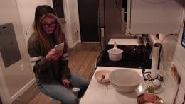 Kitt drops her phone in the sink